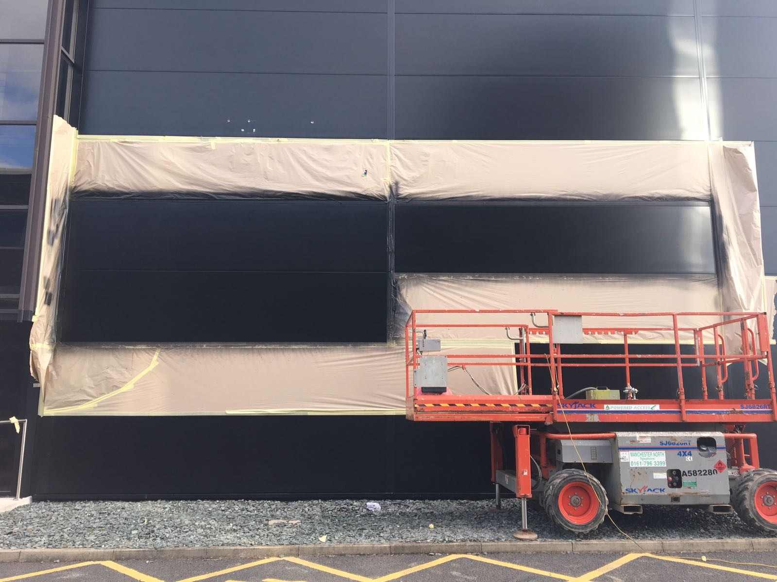 Adidas signage masked & Arcelor panels being repaired