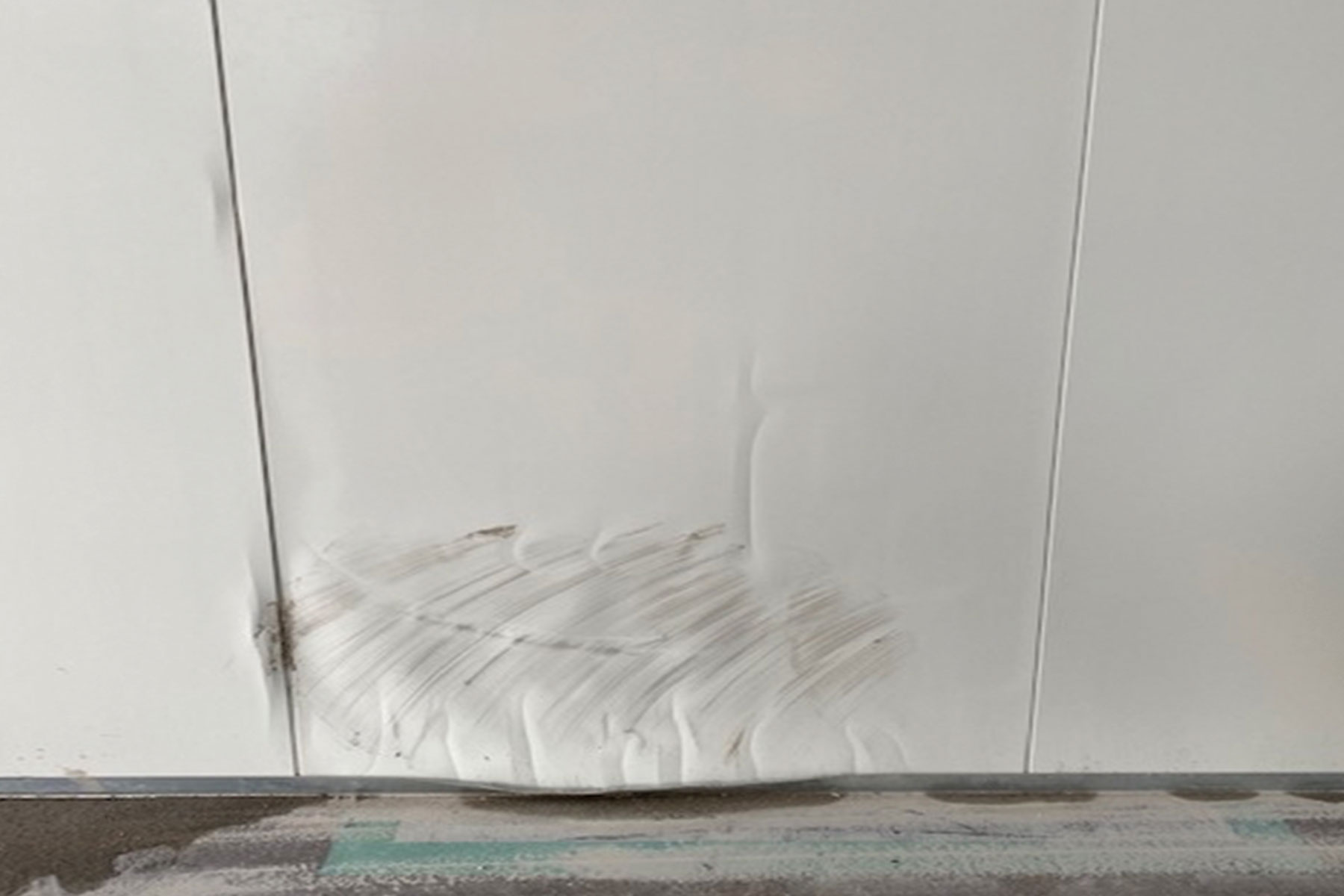 scratched cladding with dents